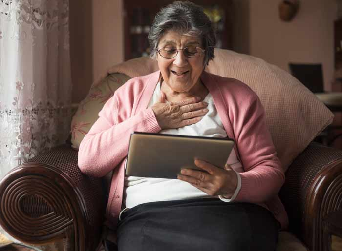 senior-woman-at-home-tablet
